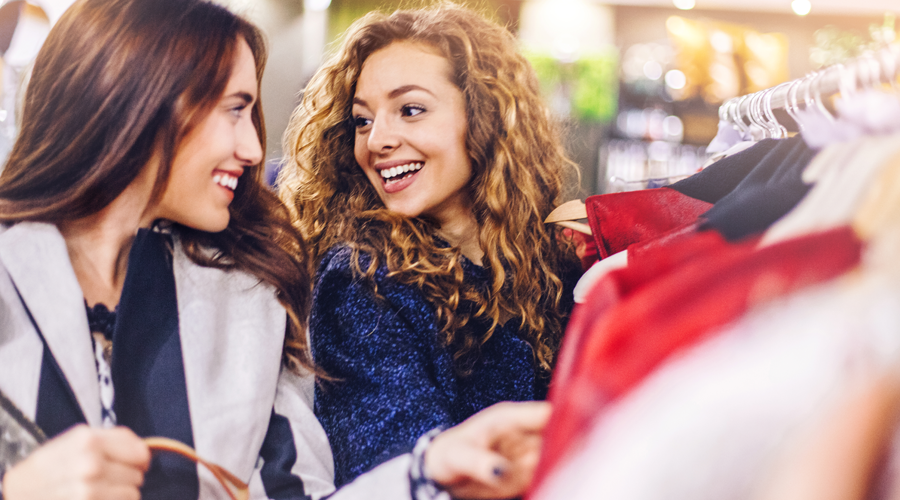 Two young female friends shopping together