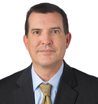 Headshot of financial adviser, David Dufour