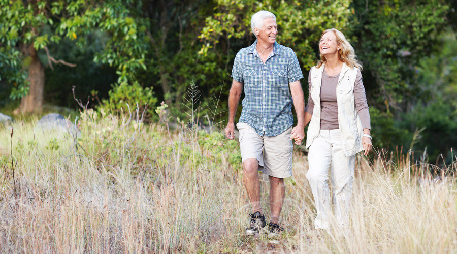 Mature couple walking in the woods