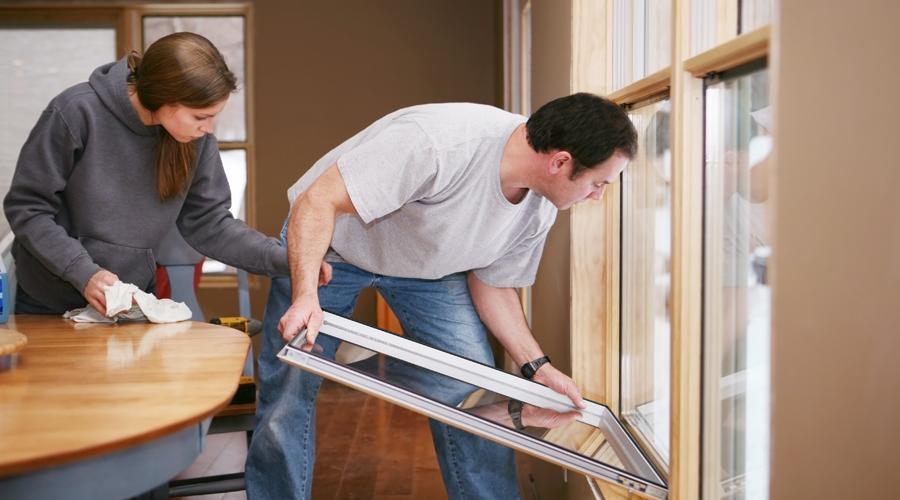 Couple installing new windows