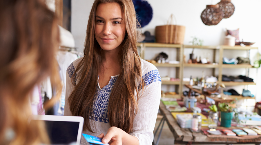Young female making a purchase with a credit card