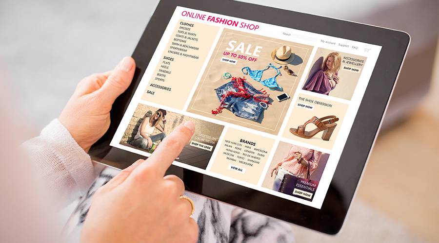 Individual shopping online on a tablet.